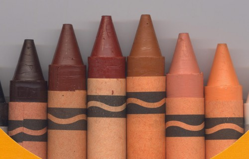 closeup of box of crayons with all skin tones