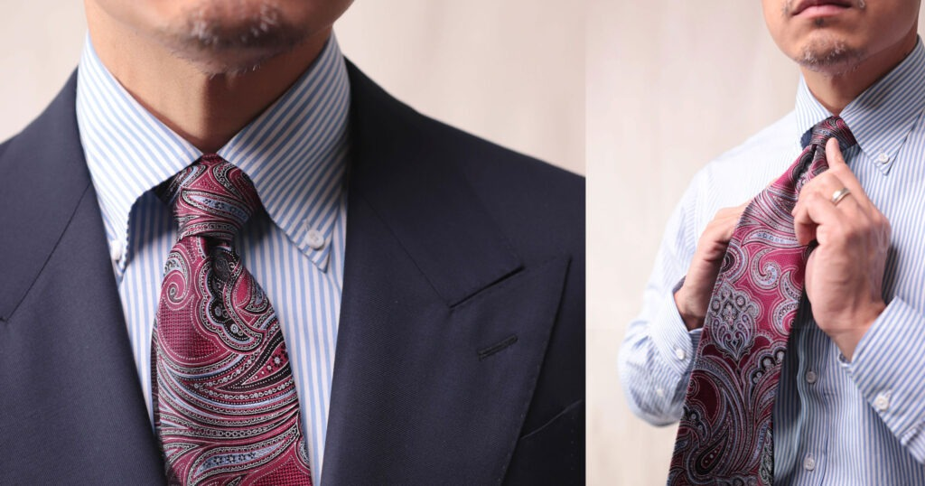 closeup of paisley tie with blue striped shirt and navy suit