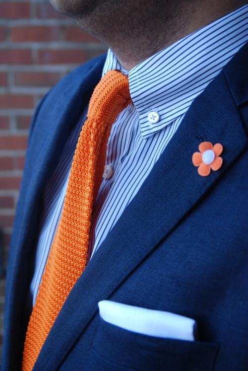 An Orange Tie against a Blue Shirt can great a bold look! This is an example of a complementary color scheme at its best! Courtesy of www.pinterest.com