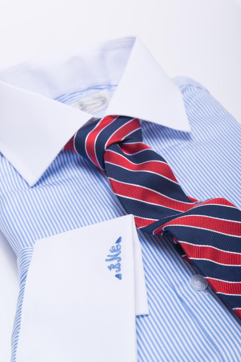 The Dark Knot's Canterbury Regimental Stripes Navy w/ Red Tie against a Blue Shirt provides for a triadic color scheme, with a harmonious balance of warm and cool colors. This helps to create visual pop.
