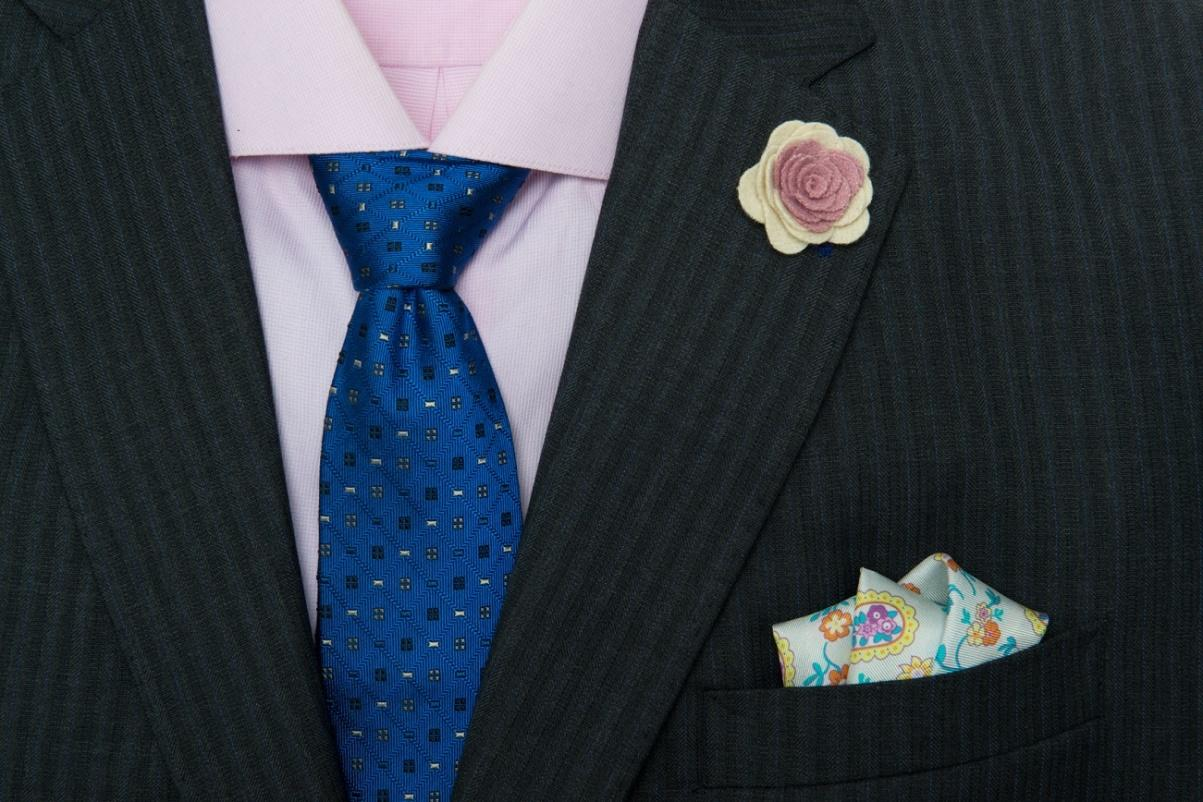 The Dark Knot's Montpelier Abstract Blue Tie against a light pink shirt provides for a great sense of harmony within a triadic color scheme (as pink is a lighter variant of red).