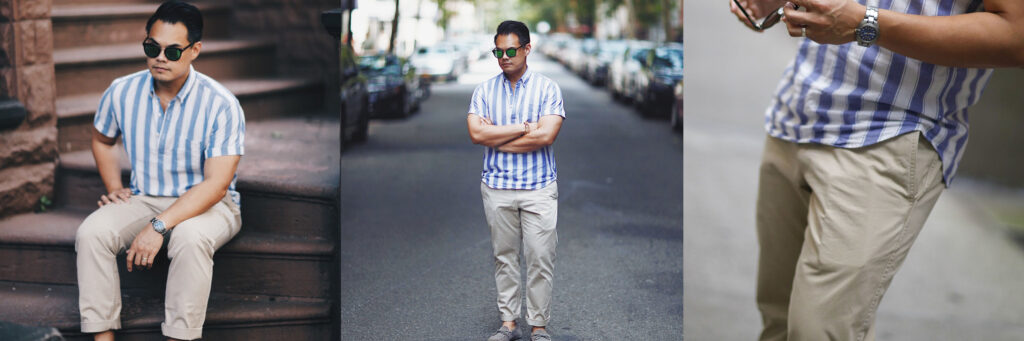 man wearing khaki chino pants and a blue and white stripe shirt with collar
