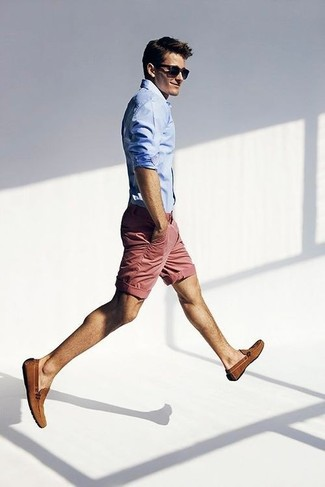 summer clothes for men - nantucket red shorts with a light blue button up shirt sunglasses and brown loafers