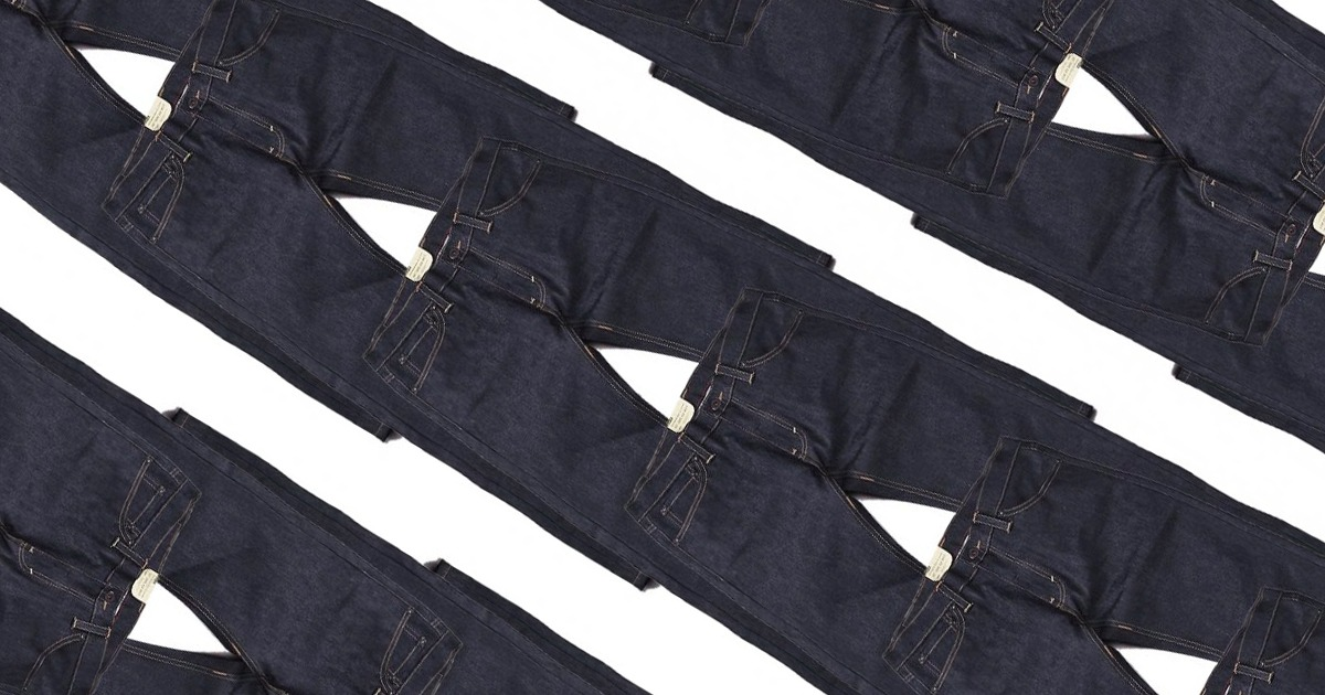 denim pants laid on top of each other in a diagonal row