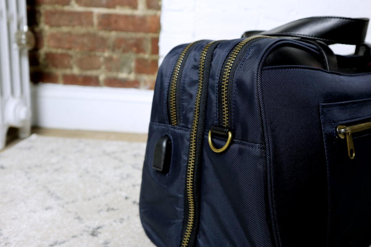 closeup of USB charger port - best travel bag for men - nomad lane bento bag