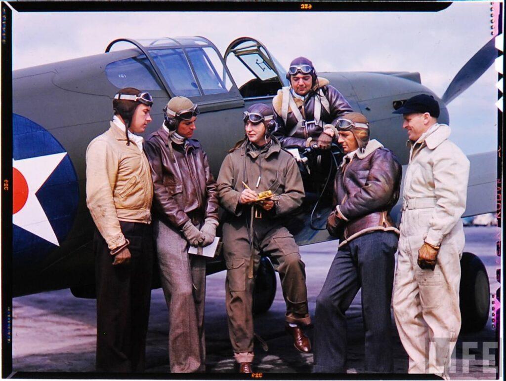vintage photo men wearing flight jackets next to a plane