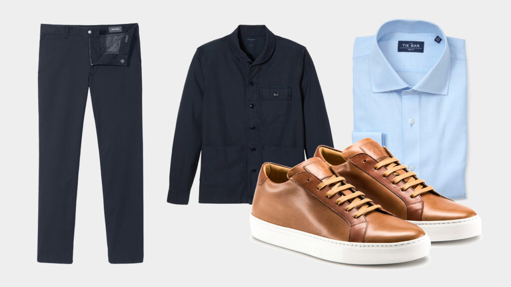 smart sharp casual outfit with Ace Marks brown dress sneakers, navy chinos, navy chore coat, and light blue dress shirt