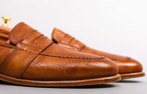 close up side view and toe box of tan leather loafers
