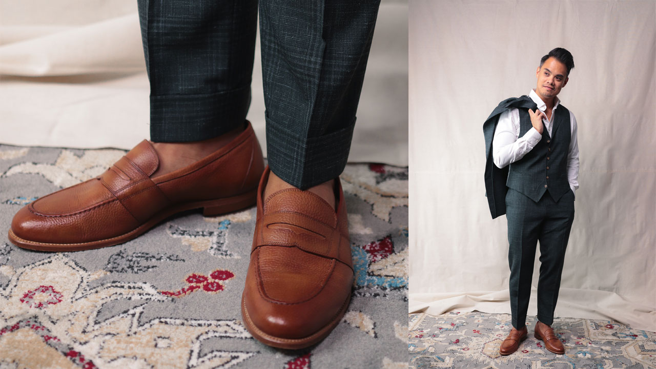 tan leather loafers with dark green three piece suit