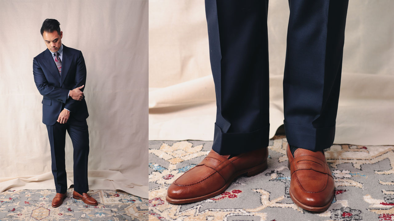 tan leather loafers with navy blue suit
