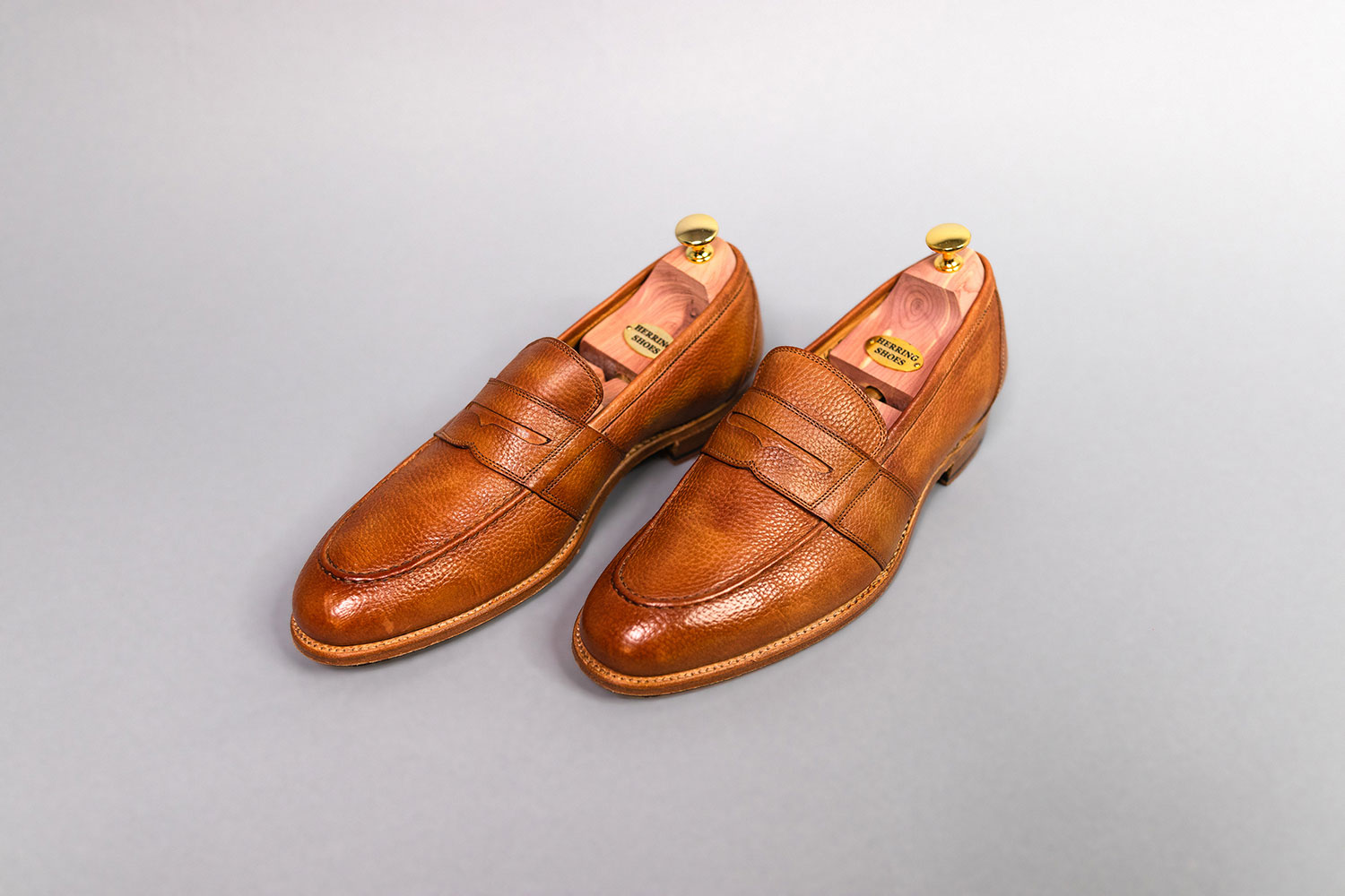 tan leather loafers from Herring facing left on gray background