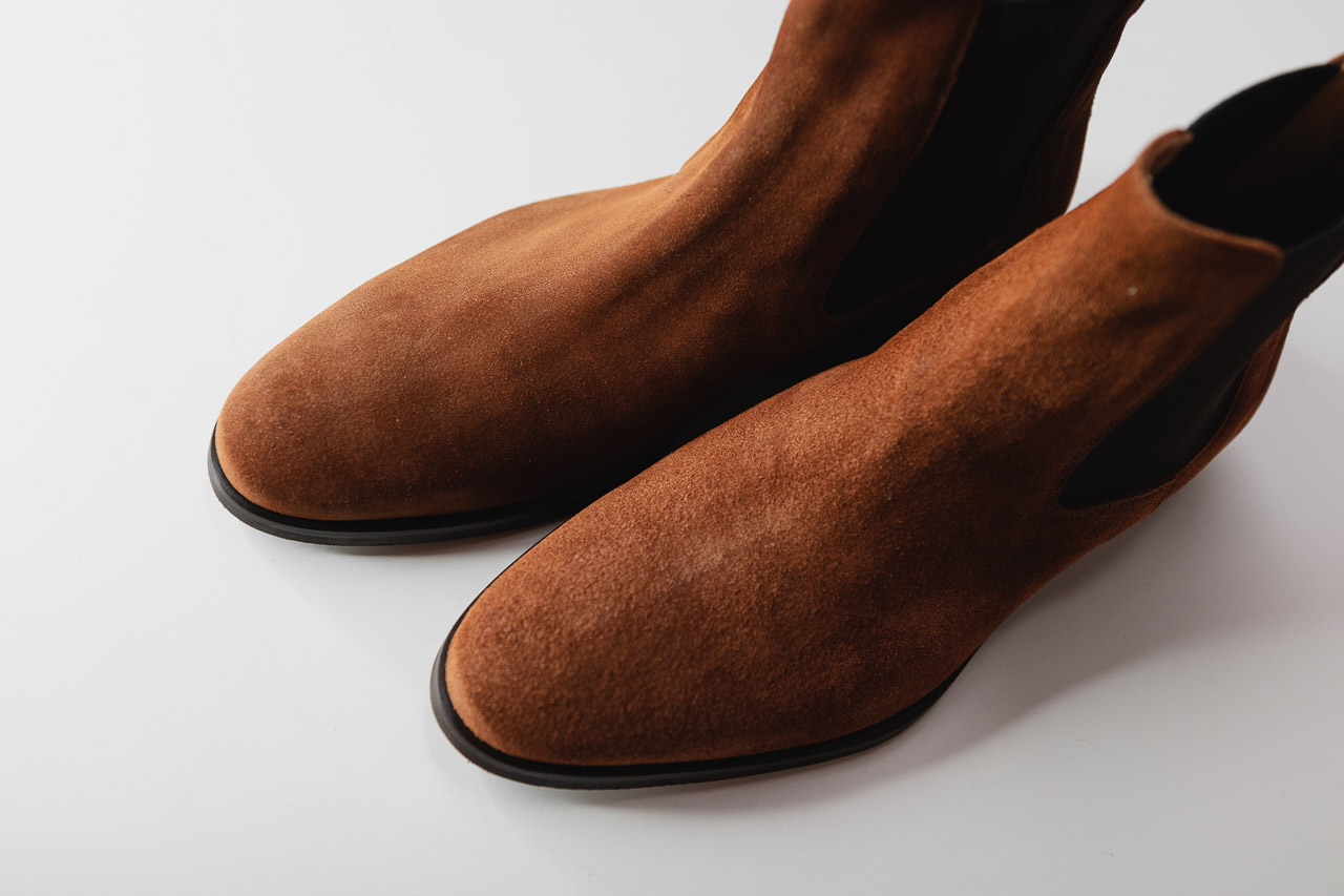 top down view of brown chelsea boots in water repellent suede