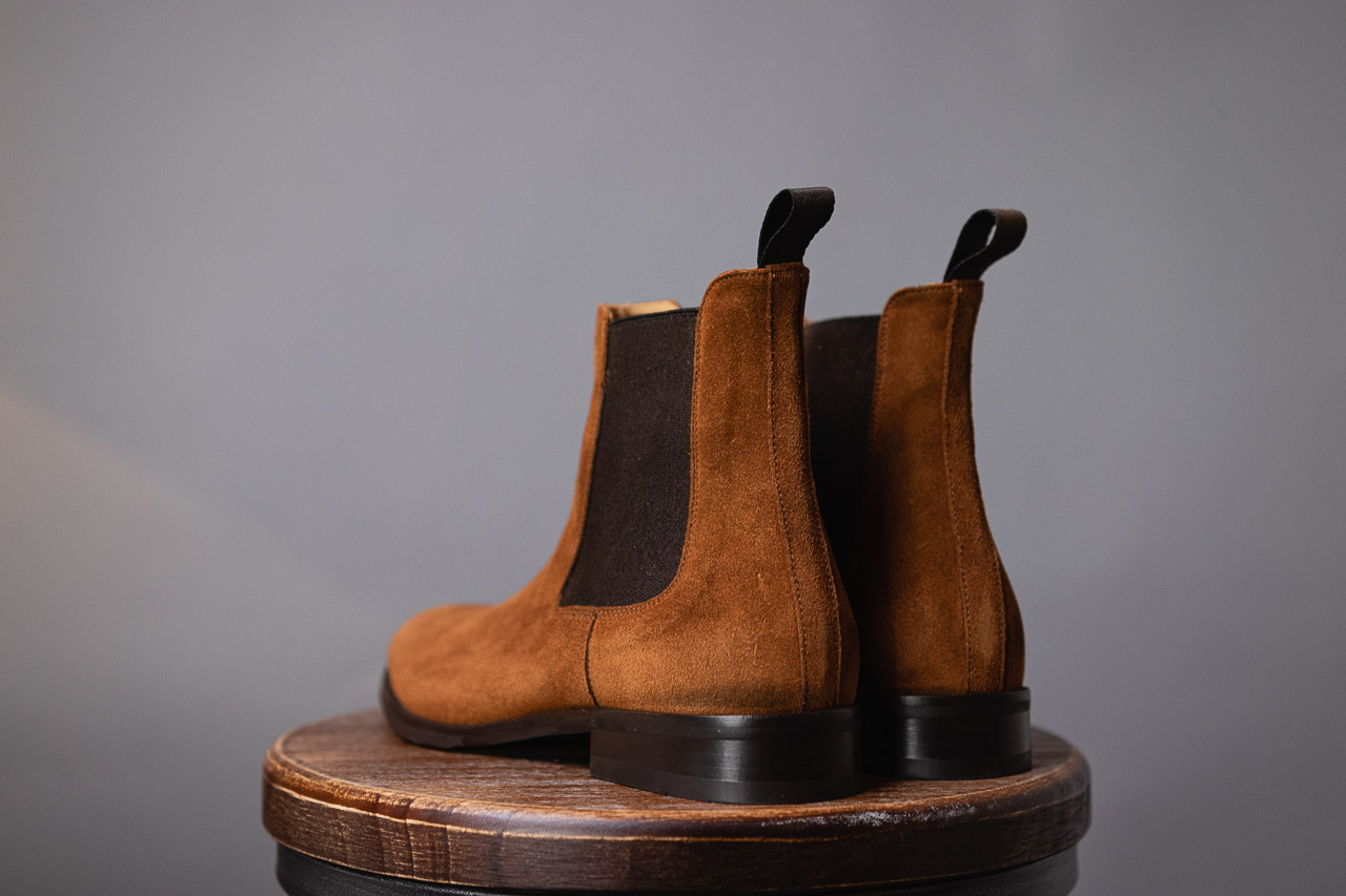 heel view of brown chelsea boots in water repellent suede