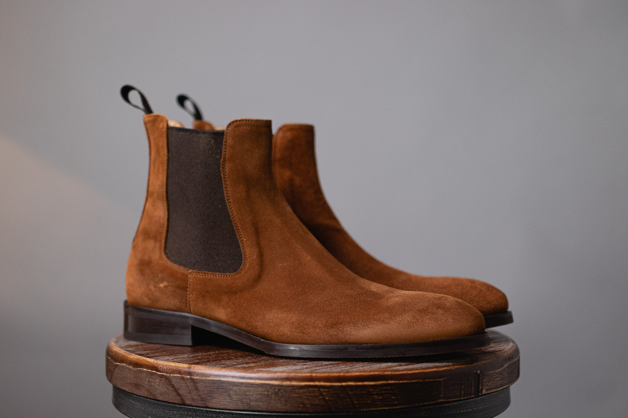 side view of brown chelsea boots in water repellent suede