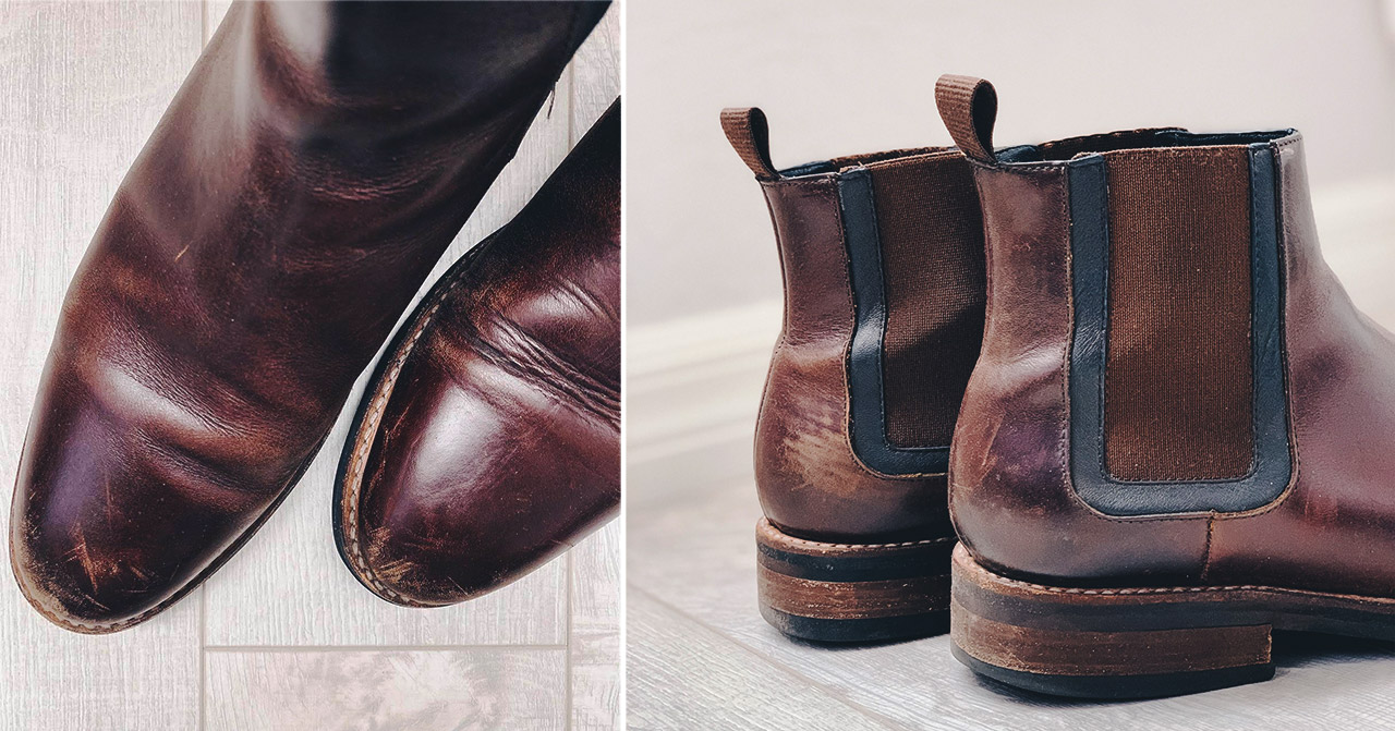 scuffed up brown leather mens boots