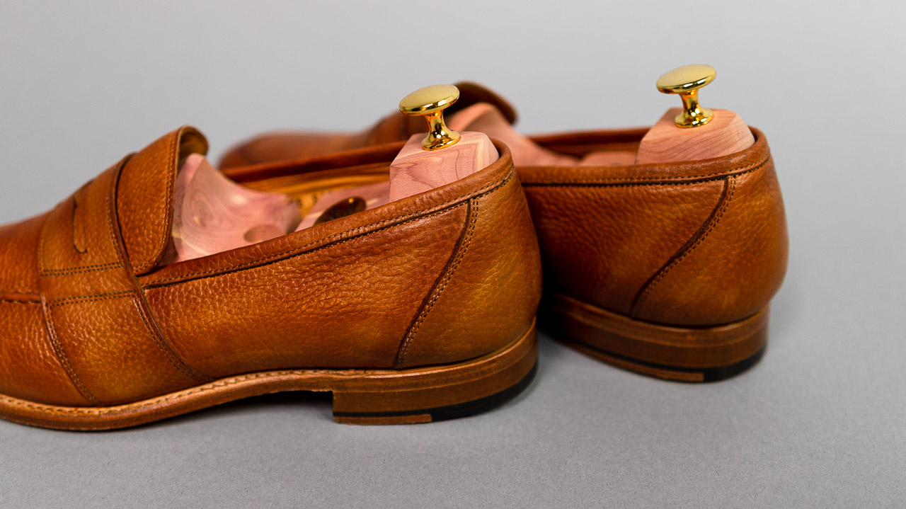 light tan loafers with cedar shoe trees inserted