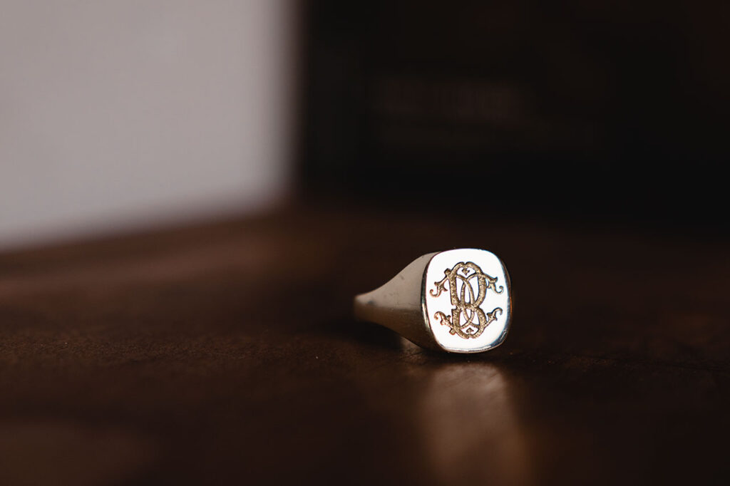 rebus traditional hand engraved initials into cushion signet ring