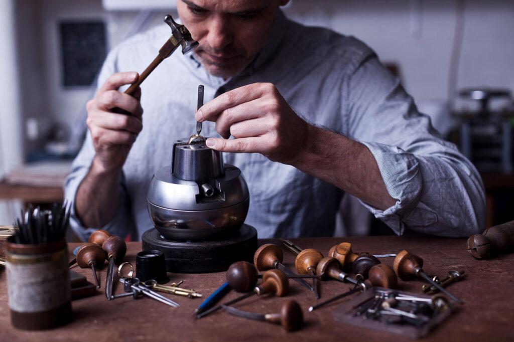 man engraving signet ring
