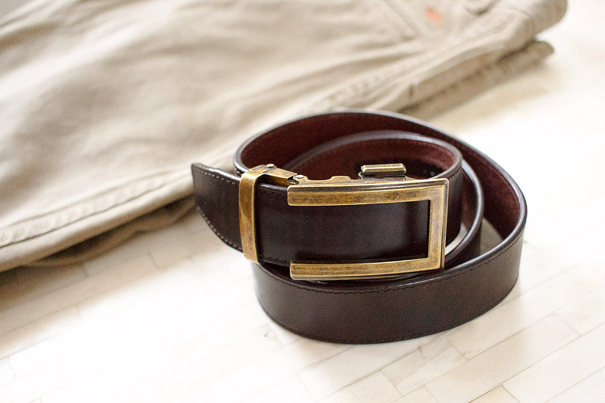 the ultimate of men's accessories - brown belt and partial display of khaki pants