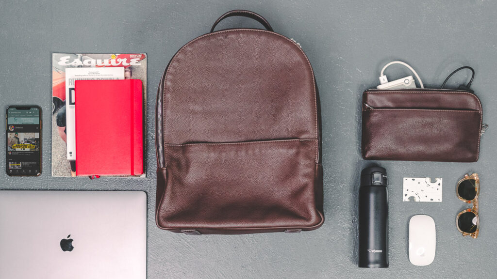 daveed leather backpack and travel pouch with everyday carry items and other men's accessories