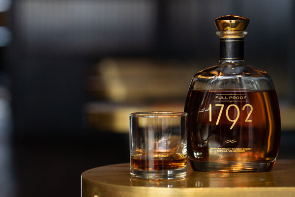 bottle of bourbon and bourbon poured in glass - how to do a bourbon tasting