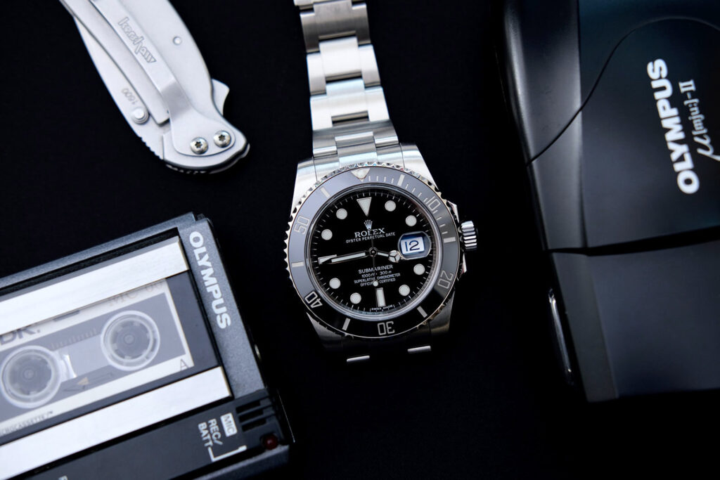 best entry level rolex - black dial submariner with vintage electronics