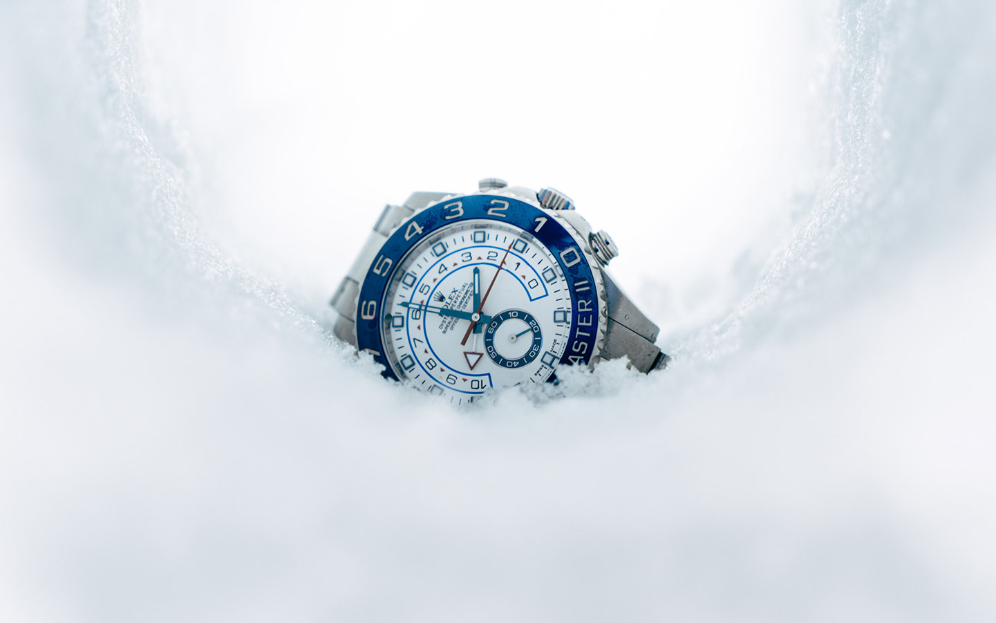 white dial rolex yacht master with blue bezel in snow