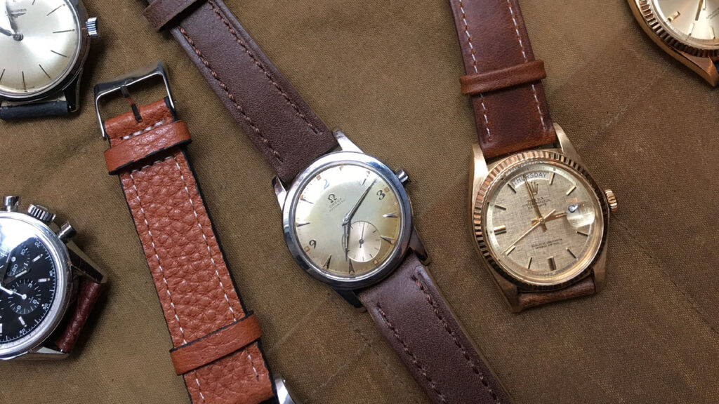 how to store watches - collection of vintage watches on canvas fabric