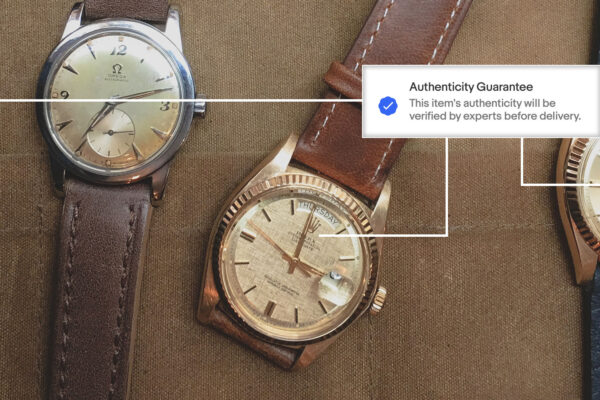 ebay authenticate watches - rolex and omega watches on tan canvas background