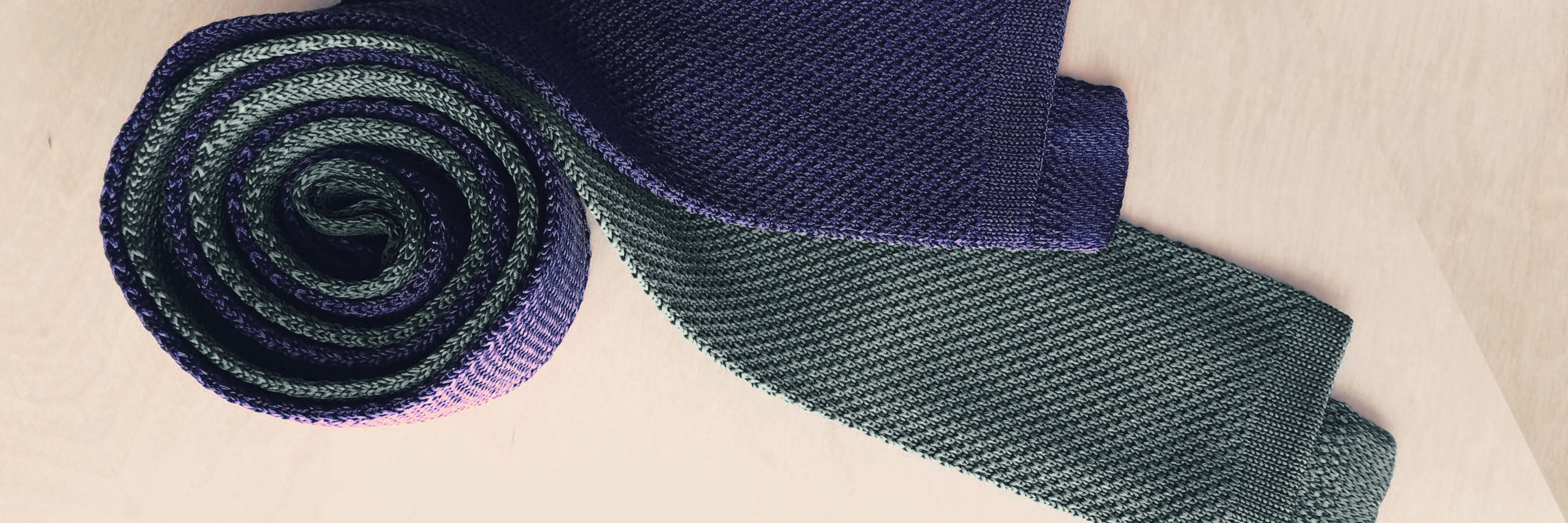 rolled up knit ties in purple and grey