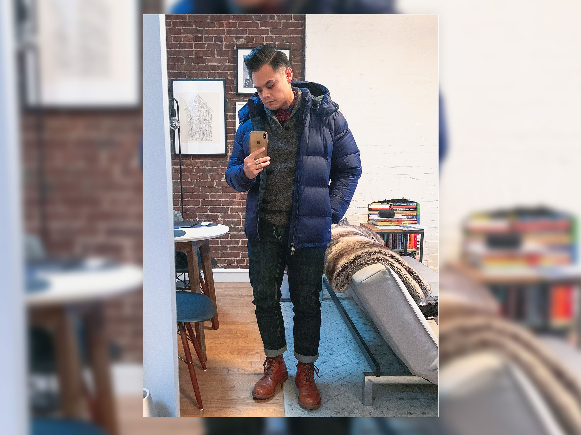 blue puffer jacket dark jeans and tan boots