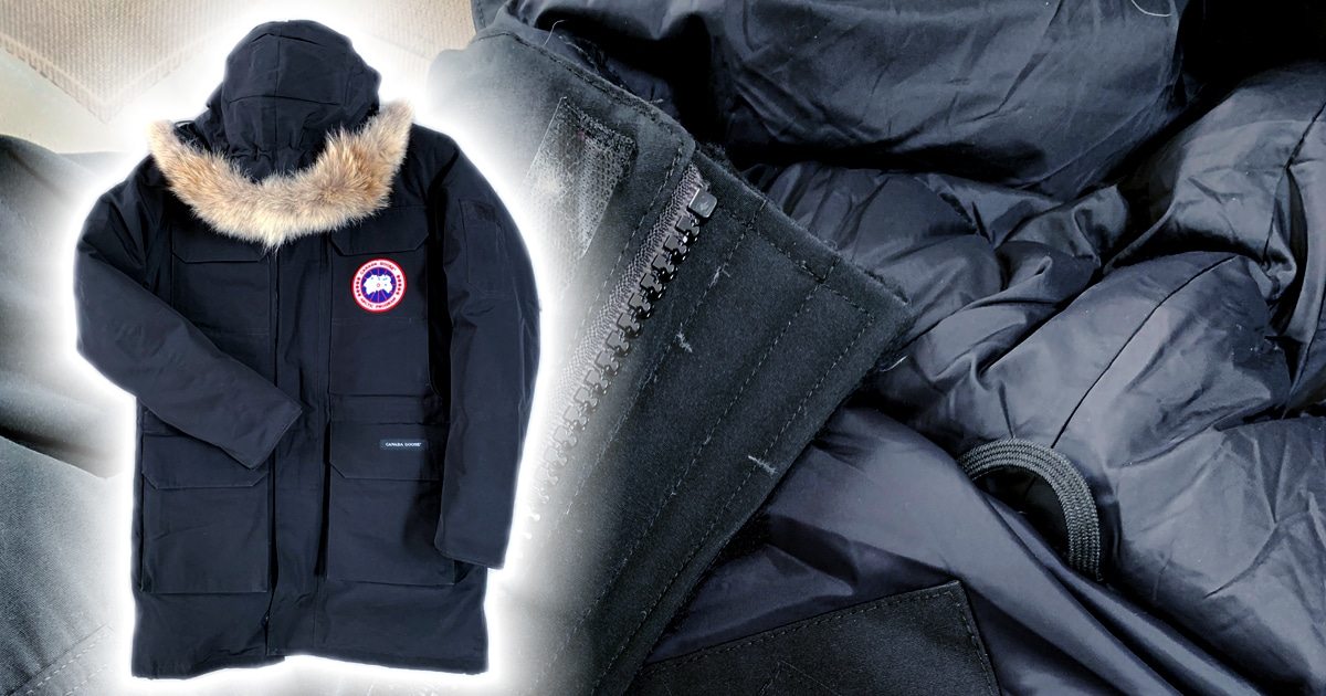 photo of a black down jacket with fur trim hood