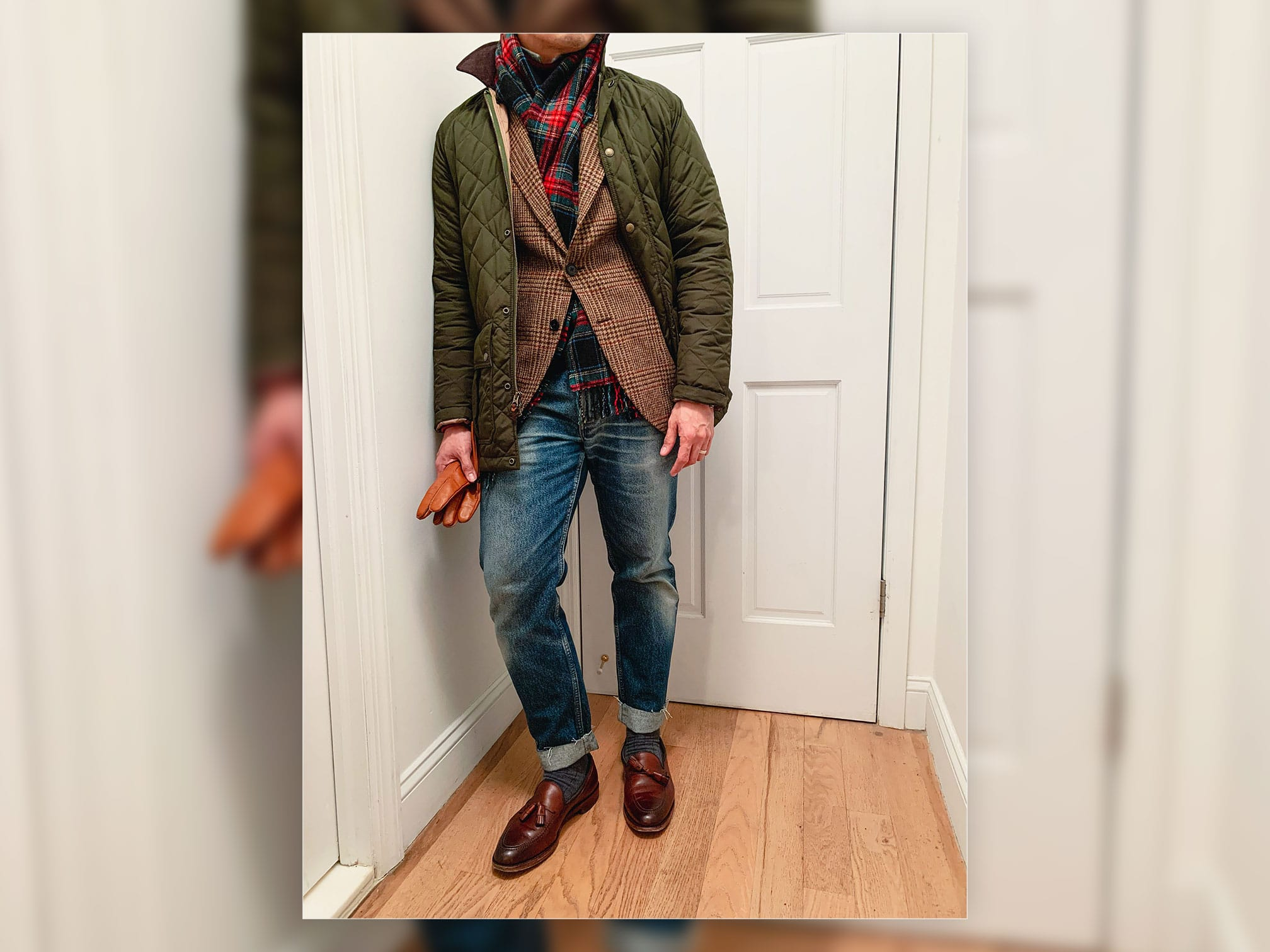 man wearing green quilted jacket and tweed plaid sportcoat with jeans and brown loafers