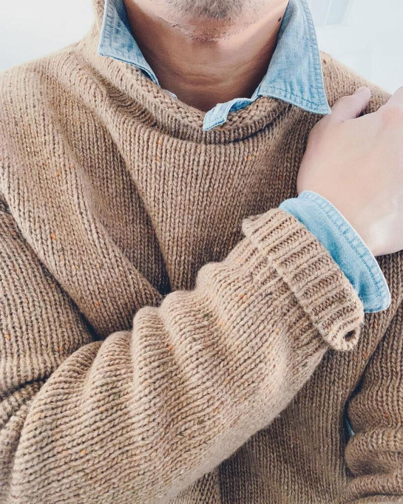 man closeup of camel rollneck sweater