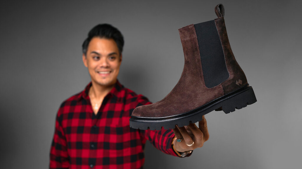man holding brown koio chelsea boots