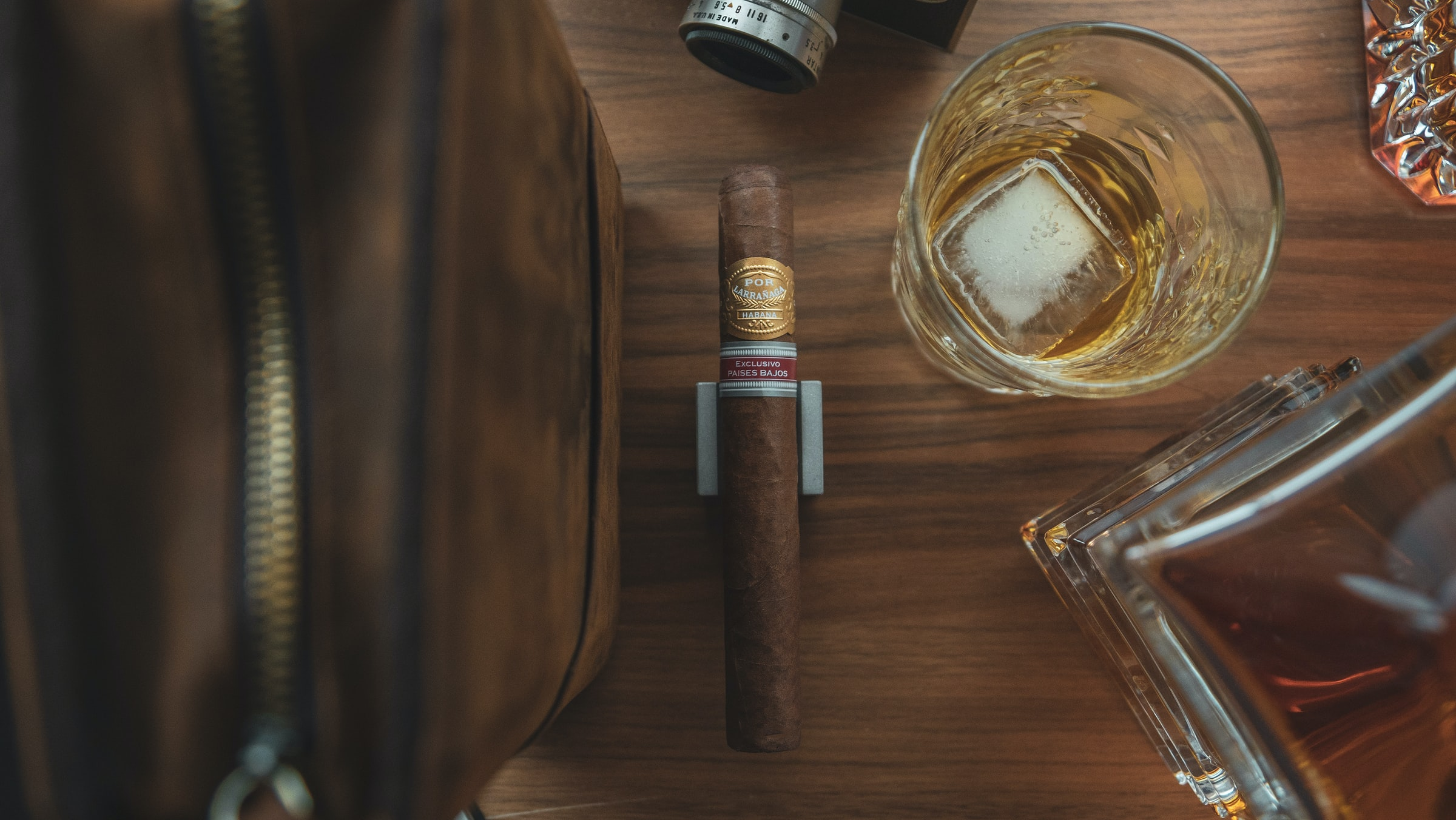 overhead shot of cigar and whiskey glass