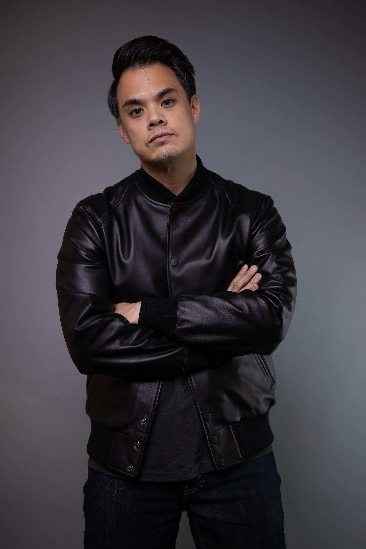man wearing black bomber baseball leather jacket