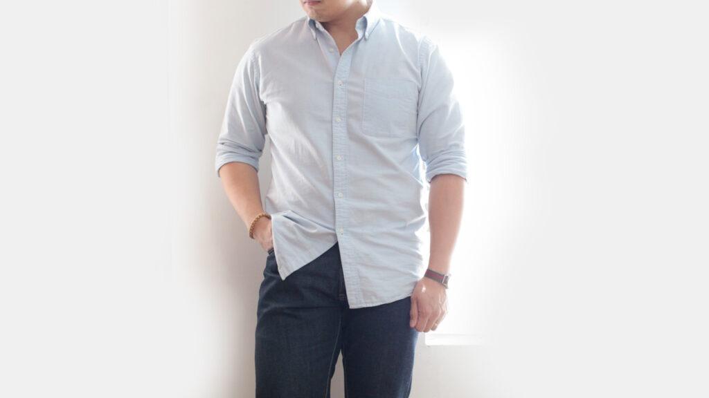 cropped photo of man wearing light blue oxford shirt