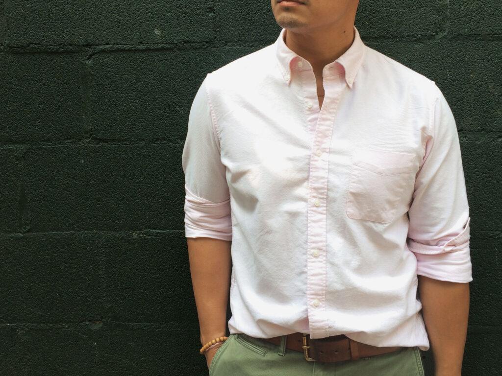 cropped photo of man wearing pink oxford shirt