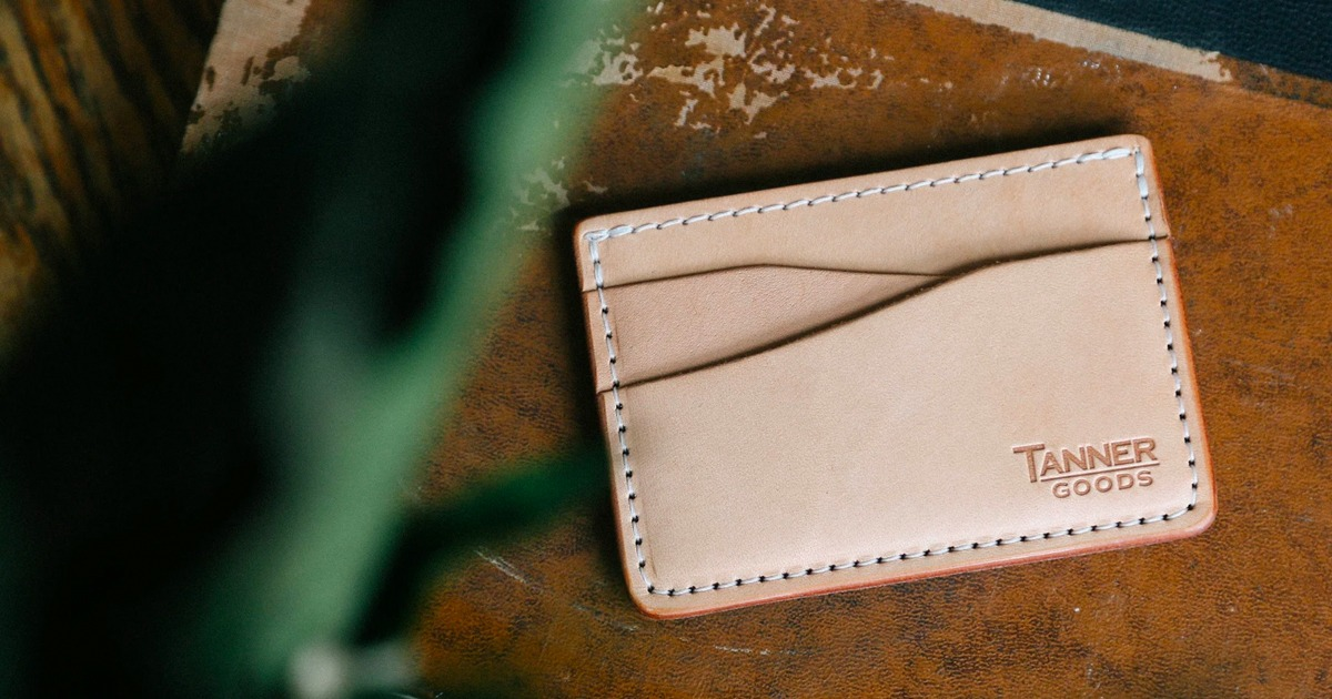 light colored leather cardholder on table