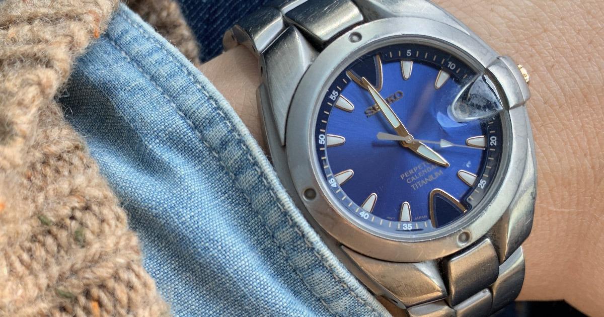 closeup of seiko quartz watch with blue face