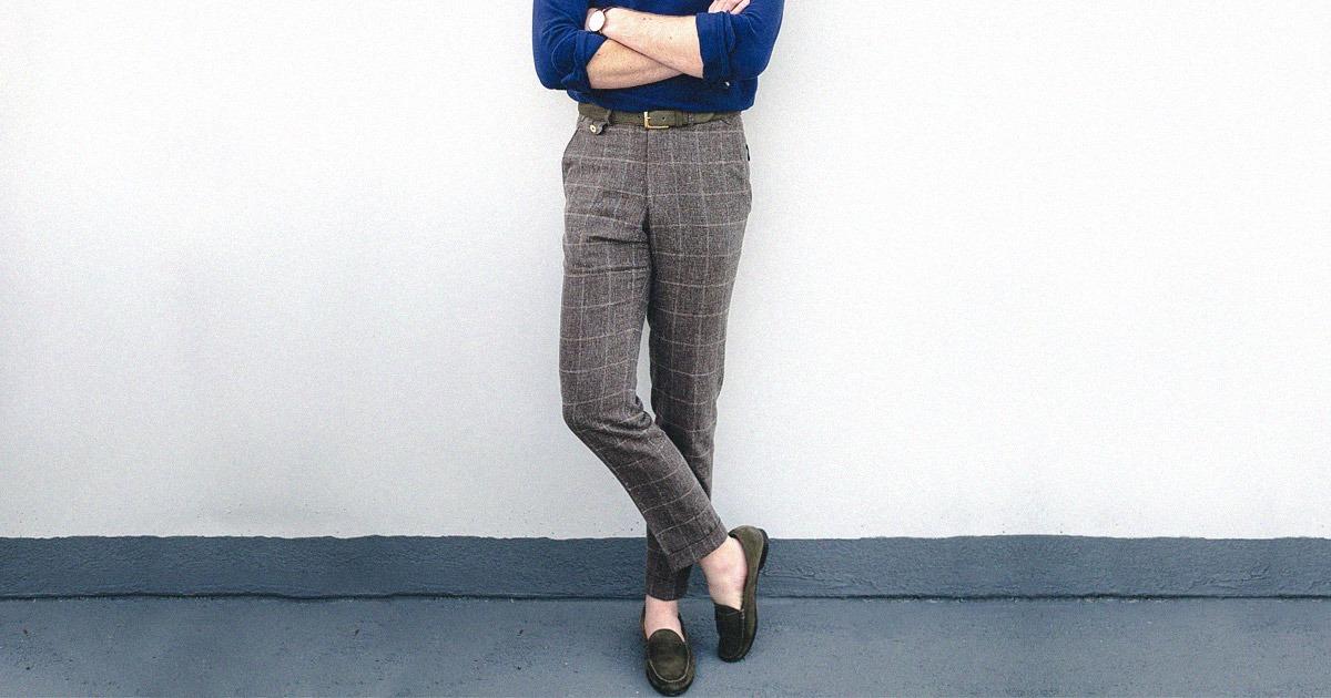 man standing wearing slacks