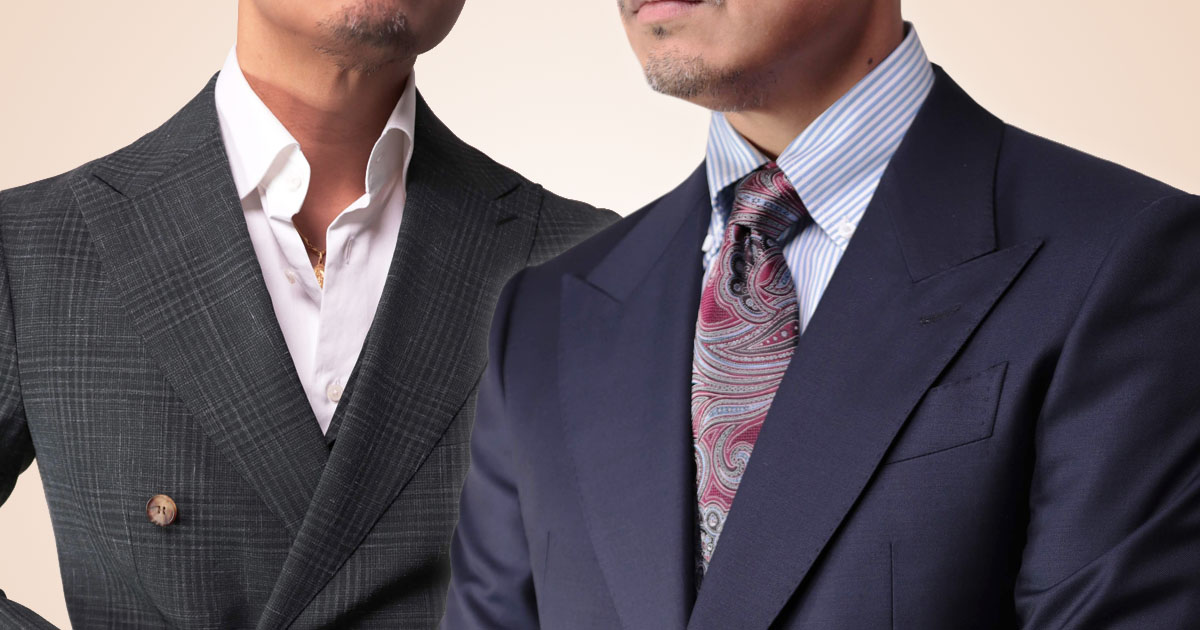 closeup photo of two men in suit jackets