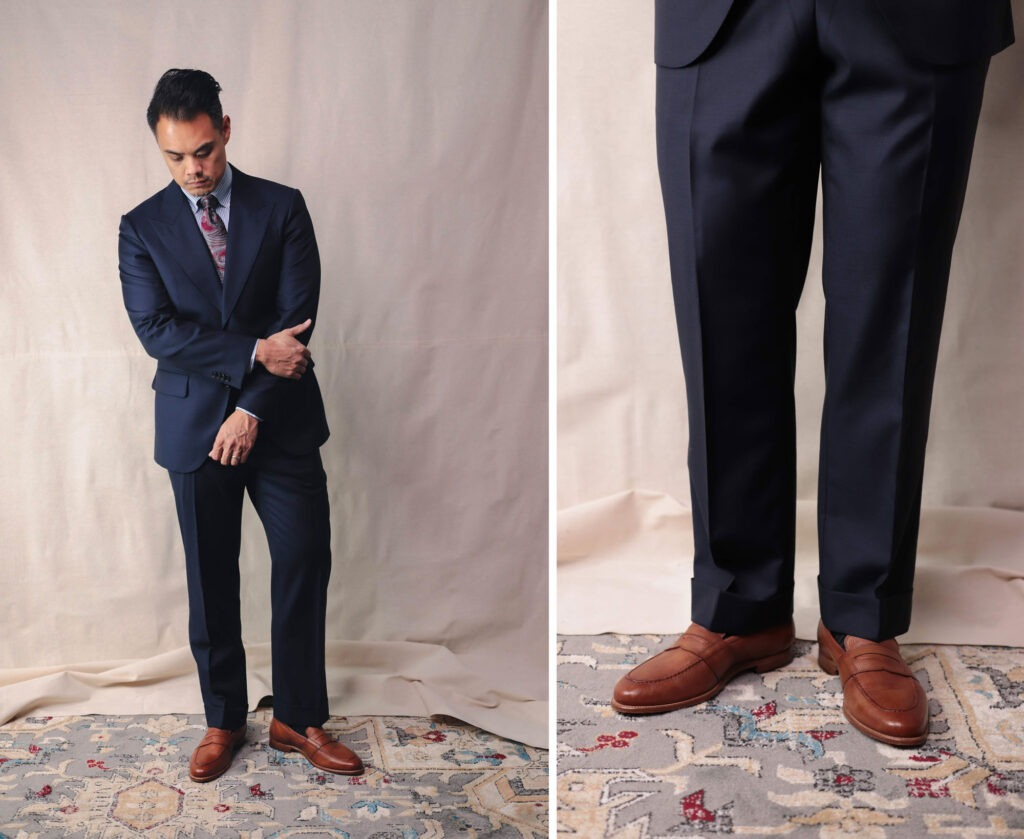 asian man wearing a nice navy suit and a closeup of the trousers and shoes